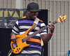 Derrick Hodge- perfoming at The 2012 Charlie Parker Festival at Marcus Garvey Park, New York City, August 25, 2012