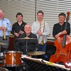 """Peter Brown and Friends<br /> <br /> In front at drums: """"Big"""" Al Harrison<br /> Back (L to R): Ian Welsh, Luke Godfrey, Dave Saxon, Peter Brown, Dave Wall"""