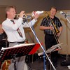 """David Saxon (trombone in hand) watching Geoff Power on trumpet - """"So that's how he does it!"""""""