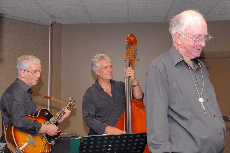 Peter Massey (guitar) and Peter Brown (bass) are concentrating while Ian Welsh thinks about his next turn.