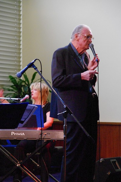 Edward Maher, proving that you're never too old to entertain... Nicole Ingram on keyboard.