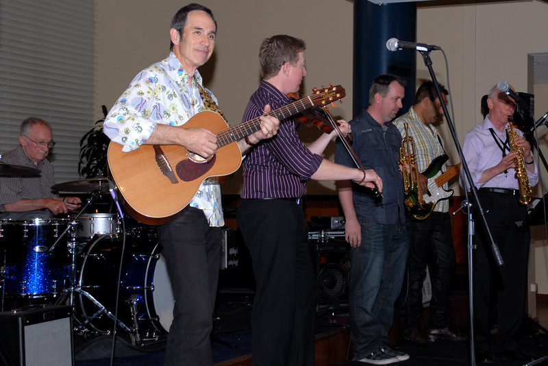 L to R: Dale Allison (guitar), Caleb Richards (fiddle), Andrew Heap (trumpet), Geoff Simpson (bass), David Kennedy (sax). And, at the rear, George Ceely on drums