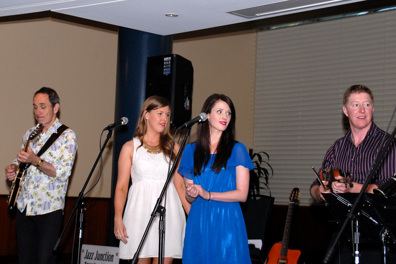 Alex Richards (white dress) joins Kelsey Holmes for a song or 3