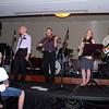 Naomi Coggan (piano accordion) joins the boys on stage