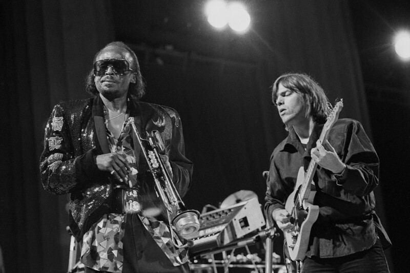 Miles Davis, pictured with guitarist Mike Stern, performs at the Greek Theater in Berkeley, CA on September 1, 1985.