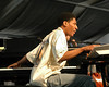 Jonathan Batiste performs at the New Orleans Jazz & Heritage Festival on May 1, 2005.
