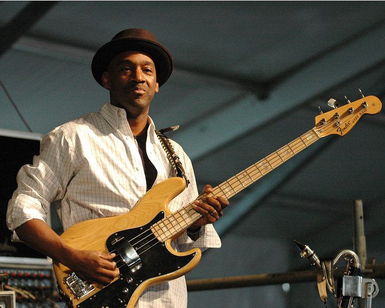 Marcus Miller performing live onstage with Herbie Hancock at the New Orleans Jazz & Heritage Festival on April 29, 2006.