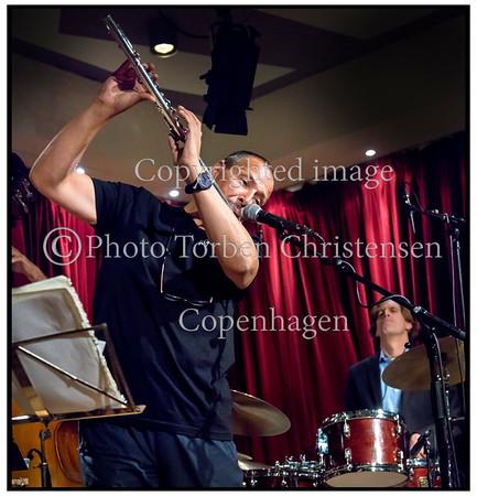 NICOLA STILO JAZZ & LATIN QUARTET på scenen i Jazzhus Montmartre torsdag 20. september 2012  Nicola Stilo (flute, guitar, piano, vocal / IT)Steen Rasmussen (piano / DK)Yasser Pino (bass / CU)Jonas Johansen (drums / DK)NICOLA STILO JAZZ & LATIN QUARTET på scenen i Jazzhus Montmartre torsdag 20. september 2012  Nicola Stilo - Fløjte, guitar, piano, vocal, Steen Rasmussen - piano, Yasser Pino -  bass og Jonas Johansen - trommer  <br />   ------   <br /> NICOLA STILO JAZZ & LATIN QUARTET on stage in Jazzhus Montmartre Thursday, September 20, 2012 Nicola Stilo (flute, guitar, piano, vocal / IT) Steen Rasmussen (piano / DK) Yasser Pino (bass / CU) Jonas Johansen (drums / DK)  Photo: © Torben Christensen © Copenhagen