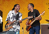 Nick Daniels and Tony Hall perform live with Ivan Neville's Dumpstaphunk at the New Orleans Jazz & Heritage Festival on May 1, 2005.