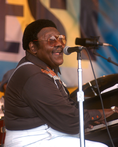 NEW ORLEANS, LA-APRIL 24: Fats Domino performing at the New Orleans Jazz & Heritage Festival on April 24, 2003. (Photo by Clayton Call/Redferns)