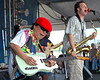 June Yamagishi and Jason Mingledorff perform with Papa Grows Funk at the New Orleans Jazz & Heritage Festival on April 28, 2005.