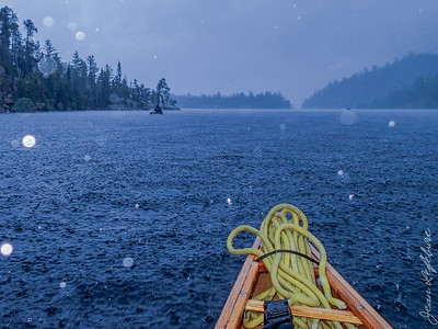 It rained for the first 2 days of our 10 day Temagami Canoe trip .... it rained REALLY hard and for hours on end! Here we are crossing Lady Evelyn Lake :(
