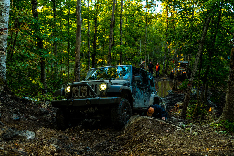 John adding a few rocks to give the longer JKU some clearance.