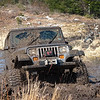Lifted Jeep Blasting Through Mud - Nova Scotia