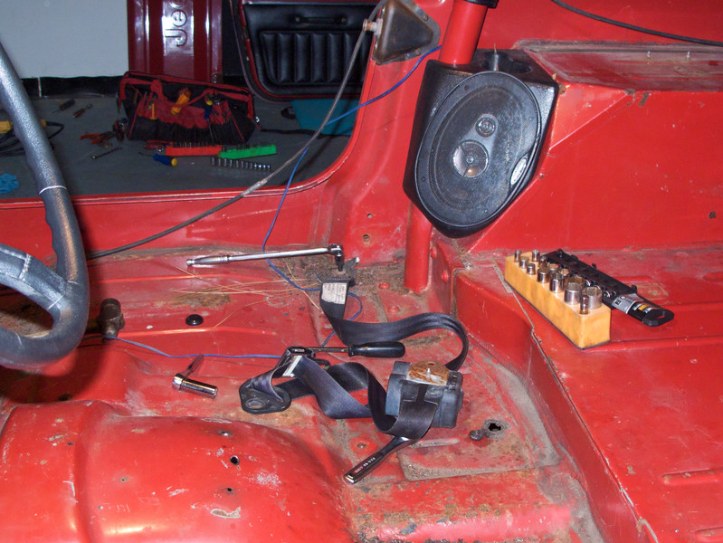 Jan 13 I began the attack on the rusty floor pans. Removing all the seat-belts was necessary.