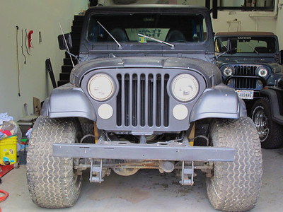 Day one, this Cj7 is a 1983. In the background are Pop's 93 Wrangler, and Lori's 84' CJ7