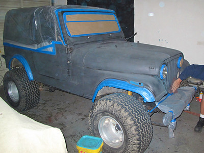 The entire jeep has been taped off for the new coat of paint
