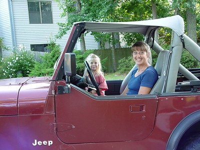 This photo of MH and Emily  was taken in July of 2001 sitting in my old CJ7 in front of our house in Salt Marsh Point.