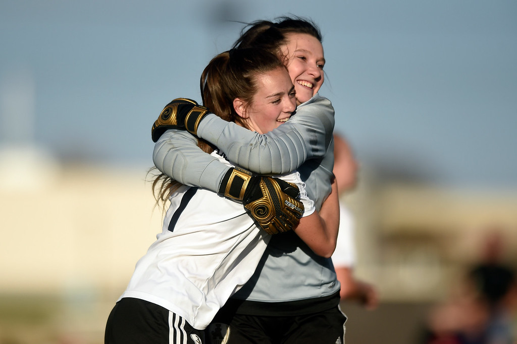 . Jefferson Academy\'s Lily Thimsen gets hug by goalkeeper Brooklynn Kirkpatrick after scoring a goal during a game against Prospect Ridge Academy on Wednesday in Broomfield. More photo: BoCoPreps.com Jeremy Papasso/ Staff Photographer 04/11/2018