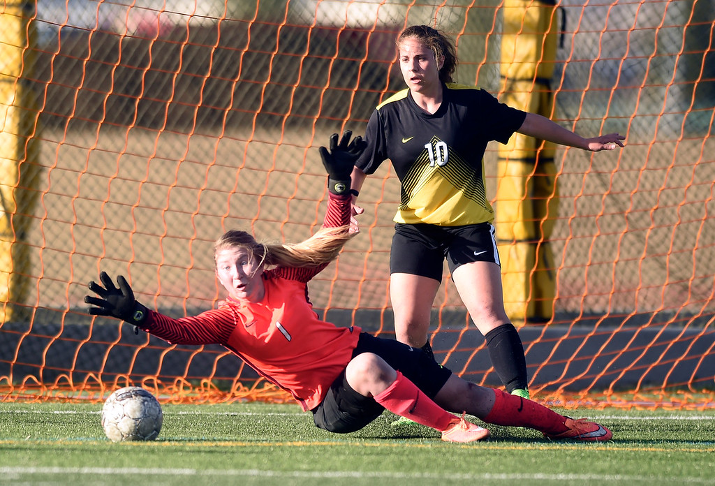 . Prospect Ridge Academy goalkeeper Linda Leahy misses a save during a game against Jefferson Academy on Wednesday in Broomfield. More photo: BoCoPreps.com Jeremy Papasso/ Staff Photographer 04/11/2018