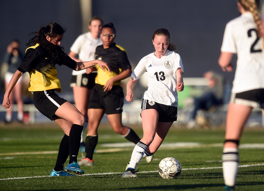 . Jefferson Academy\'s Abby VanDyke moves the ball upfield during a game against Prospect Ridge Academy on Wednesday in Broomfield. More photo: BoCoPreps.com Jeremy Papasso/ Staff Photographer 04/11/2018