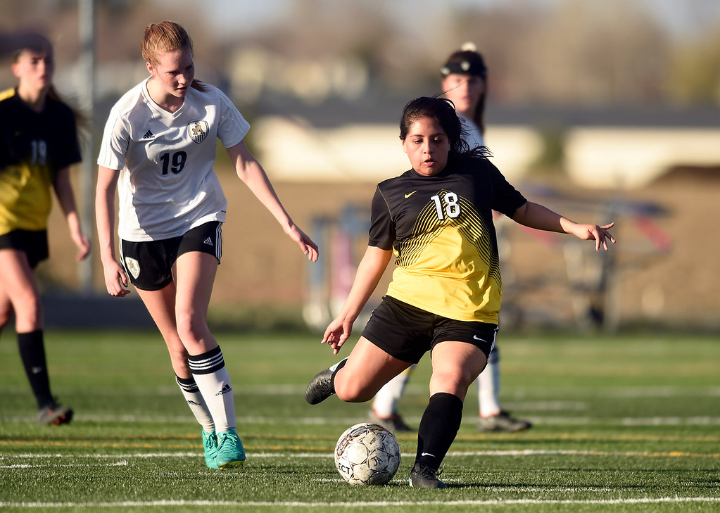 . Prospect Ridge Academy\'s Tatum Abram passes the ball upfield during a game against Jefferson Academy on Wednesday in Broomfield. More photo: BoCoPreps.com Jeremy Papasso/ Staff Photographer 04/11/2018
