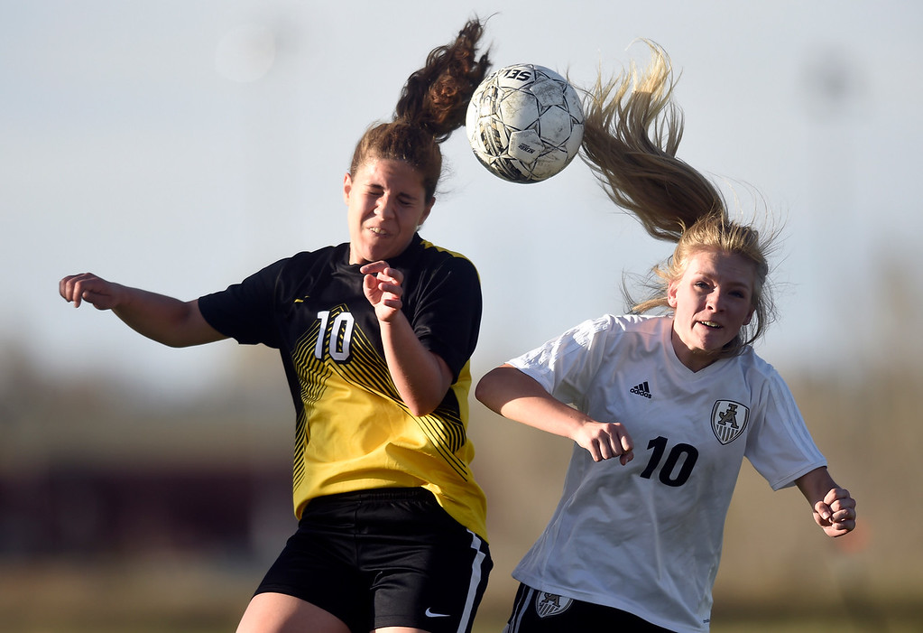 . Prospect Ridge Academy\'s Brookelyn Jordan tries to head the ball over Makenna Stull during a game against Jefferson Academy on Wednesday in Broomfield. More photo: BoCoPreps.com Jeremy Papasso/ Staff Photographer 04/11/2018