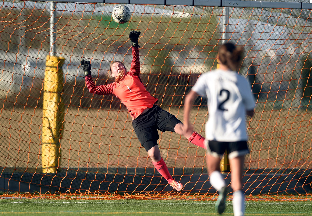. Prospect Ridge Academy goalkeeper Linda Leahy makes a save during a game against Jefferson Academy on Wednesday in Broomfield. More photo: BoCoPreps.com Jeremy Papasso/ Staff Photographer 04/11/2018