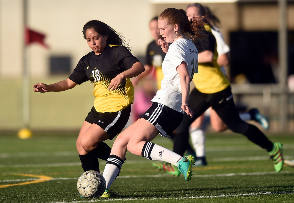. Jefferson Academy\'s Denae Lamb kicks a goal past Araceli Silva during a game against Prospect Ridge Academy on Wednesday in Broomfield. More photo: BoCoPreps.com Jeremy Papasso/ Staff Photographer 04/11/2018