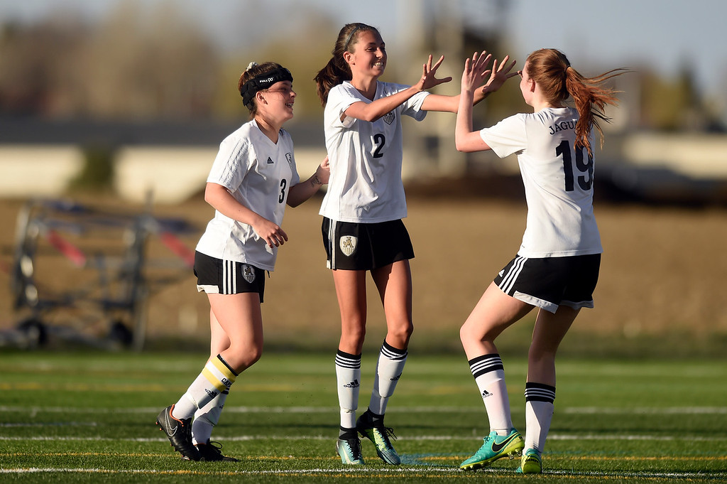 . Jefferson Academy\'s Kara Dobbs, at center, is congratulated on a goal by teammate Denae Lamb during a game against Prospect Ridge Academy on Wednesday in Broomfield. More photo: BoCoPreps.com Jeremy Papasso/ Staff Photographer 04/11/2018