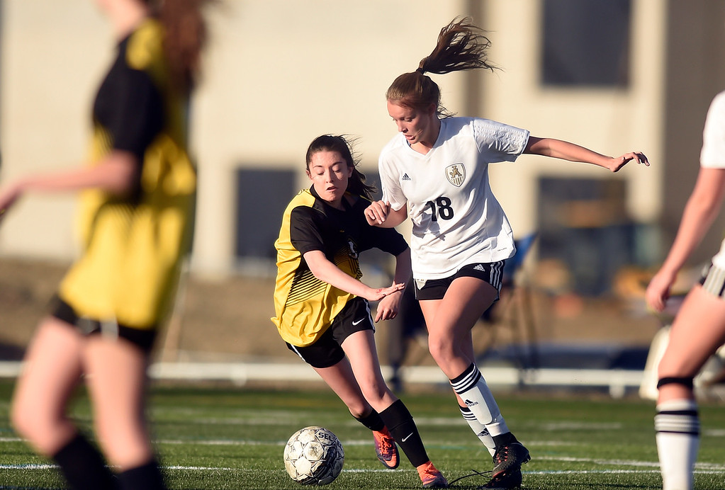 . Jefferson Academy\'s Taylor Garthwaite moves the ball past Venessa Bustamante during a game against Prospect Ridge Academy on Wednesday in Broomfield. More photo: BoCoPreps.com Jeremy Papasso/ Staff Photographer 04/11/2018