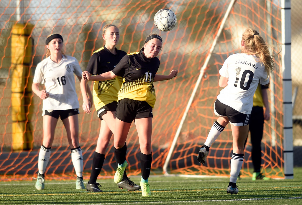 . Prospect Ridge Academy\'s Lily Fletcher heads the ball during a game against Jefferson Academy on Wednesday in Broomfield. More photo: BoCoPreps.com Jeremy Papasso/ Staff Photographer 04/11/2018