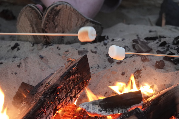Visitors to Cannon Beach like to get on the sand in the evening and make s'mores.