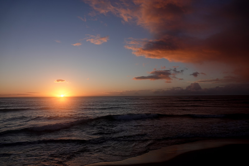 The sun rises over the south side of the Keaui island
