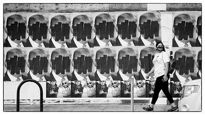 Woman walking down Melrose Avenue on 10/10/20