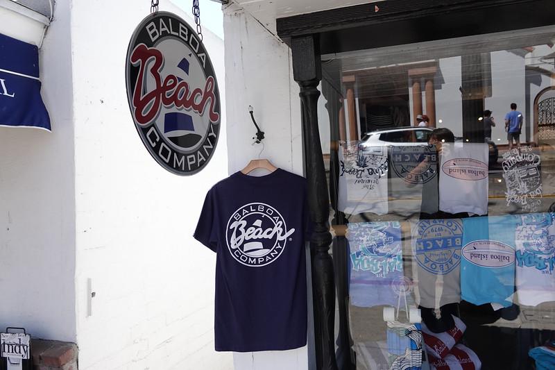 A local T-shirt shop selling Balboa beach themed merchandise.
