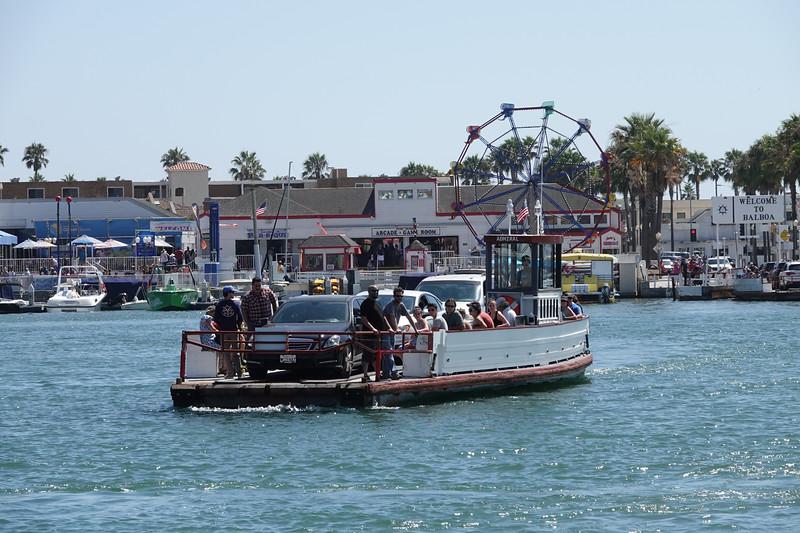 The Balboa Island ferry heads to the Balboa Peninsula and the Fun Zone