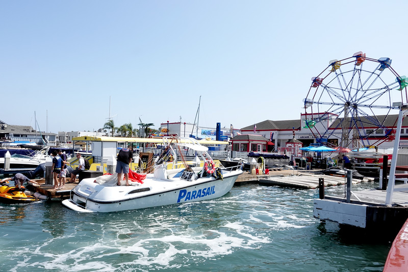 A boat bringing passengers Parasailing outside the Balboa Peninsula Fun Zone