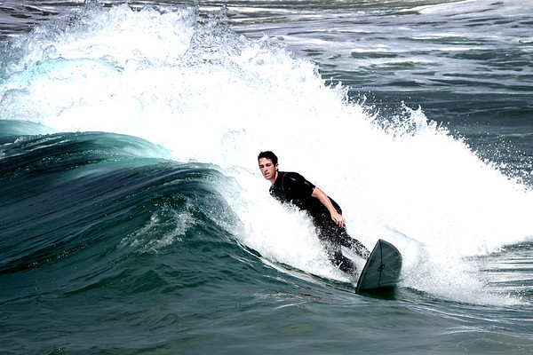 "Surfing in the waters of Huntington Beach, which is said to have the most ""consistent"" waves in California."