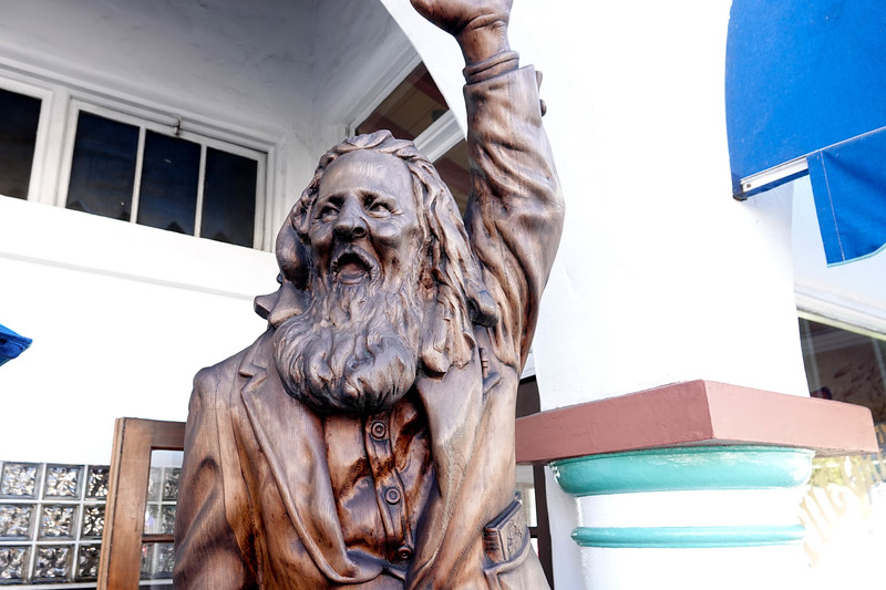 "Eiler Larsen was immortailized on this statue as Laguna's official ""greeter."" He used to stand on street corners and welcome people to Laguna. He died in 1975, burt lives on in front of the Greeter's Corner restaurant."