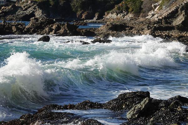 Waves crash against the Laguna Beach rocks