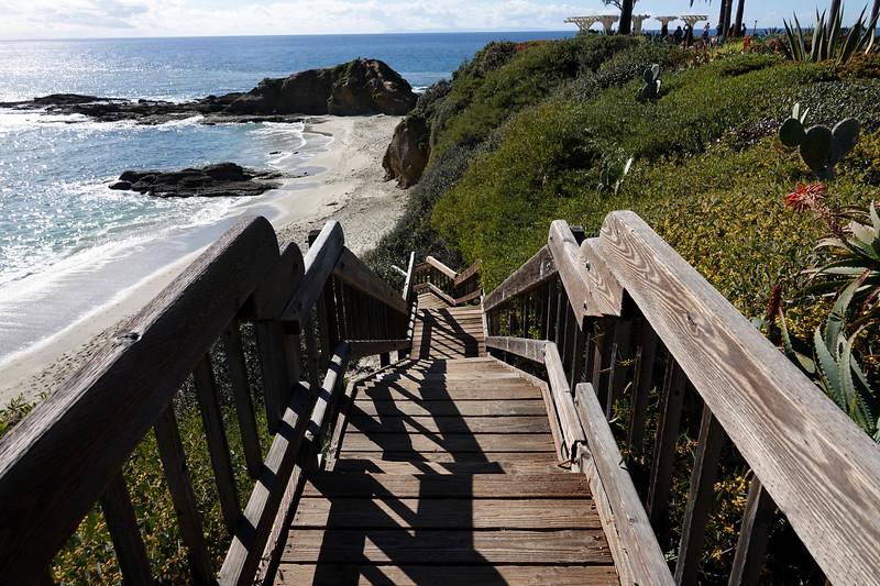 Walking down some steps to a beach in Laguna