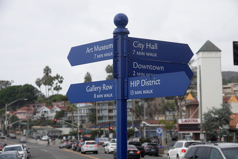 Signs in Laguna Beach point to the Art museum and the HIP District