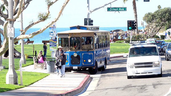 Locals urge tourists to ride the free Trolley to ease up traffic