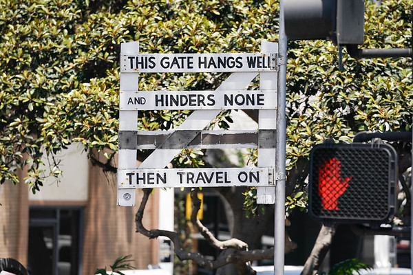 """""""This gate hangs well and hunders none,"""" sign has been hanging in downtown Laguna Beach for years"""