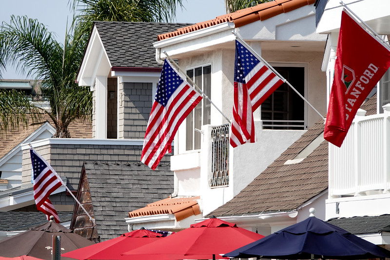 Flags are plentiful in Balboa Island, both with American flags, and schools.