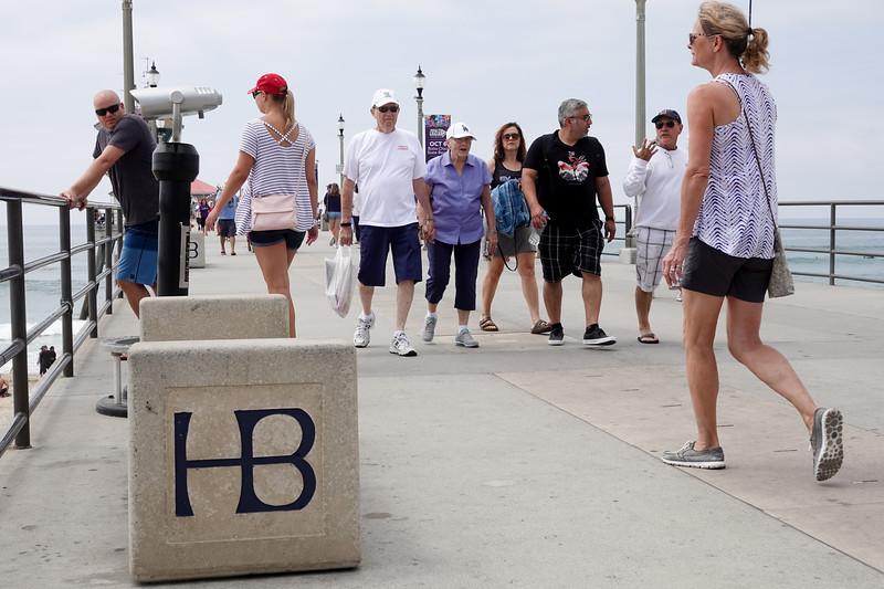 Walking along the Huntington Beach Pier