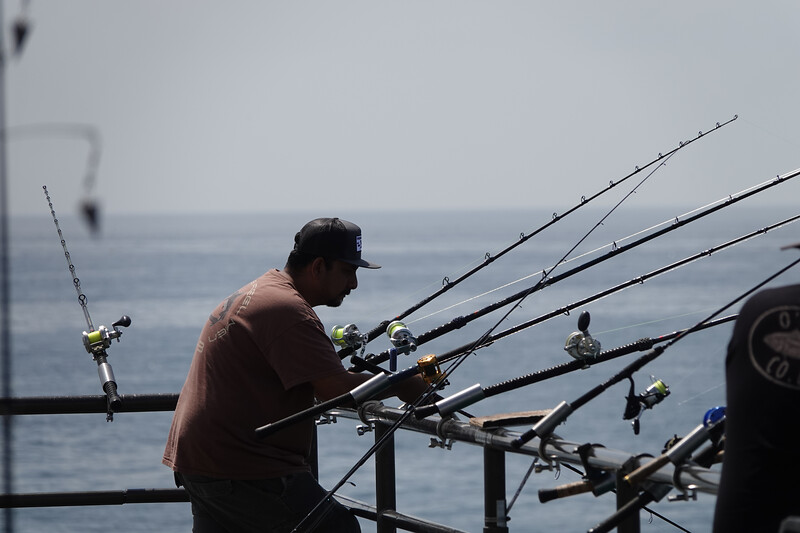 Fishing from the end of the Huntington Beach Pier