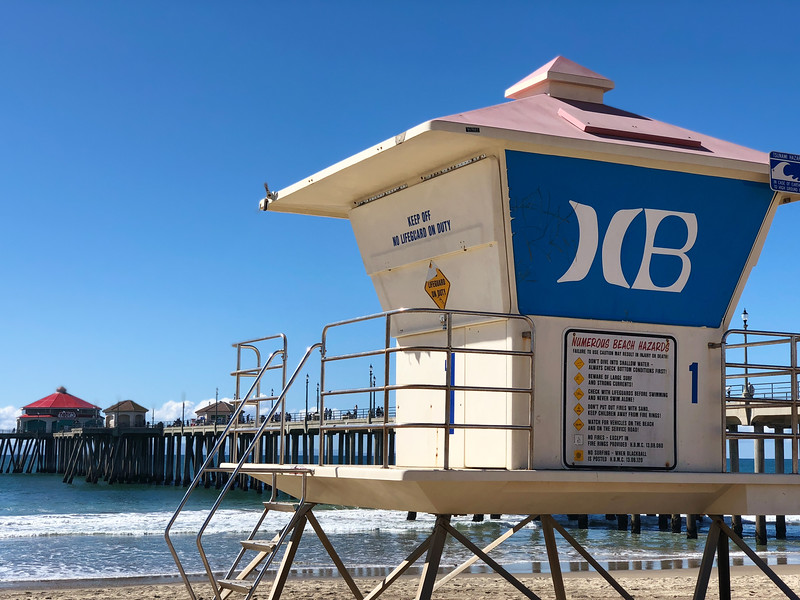 """The Huntington Beach Pier in the background, with a HB lifeguard station in front. Huntington Beach, California is """"Surf City,"""" as sung by Jan & Dean in 1963. Join us on a photo tour of Huntington Beach"""