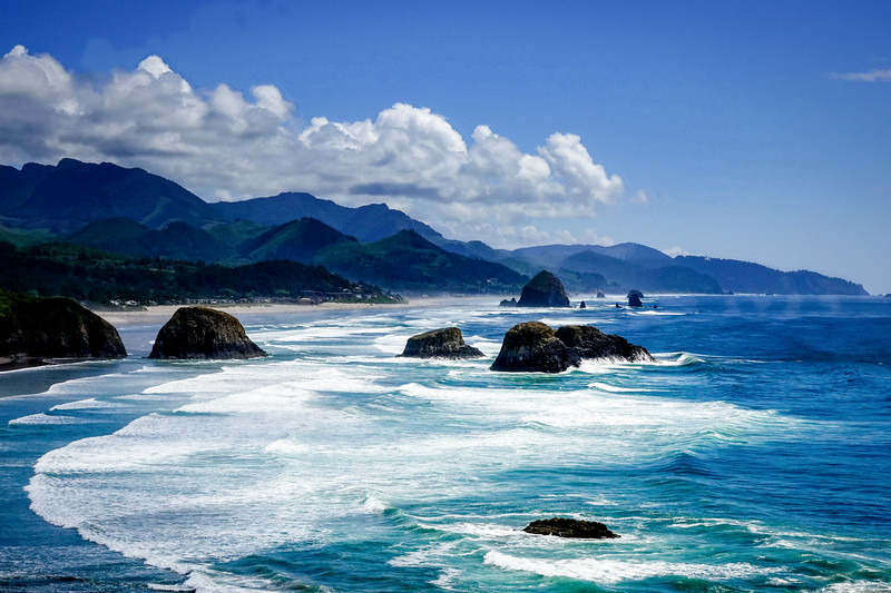 A collection of photographs from Cannon Beach, Oregon, beginning with a view of the Haystack Rock, from Ecola State Park, about two miles out of town.